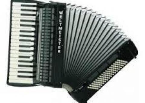 śpiewający akordeonista