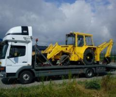 Transport maszyn rolniczych i budowlanych lawetami transport niskopodwoziowy
